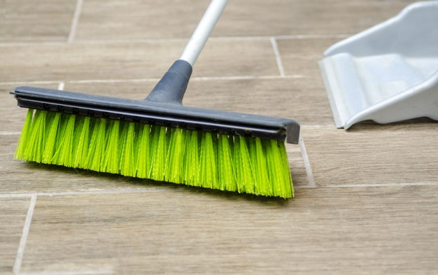 Using a broom to Clean Carpeted Stairs
